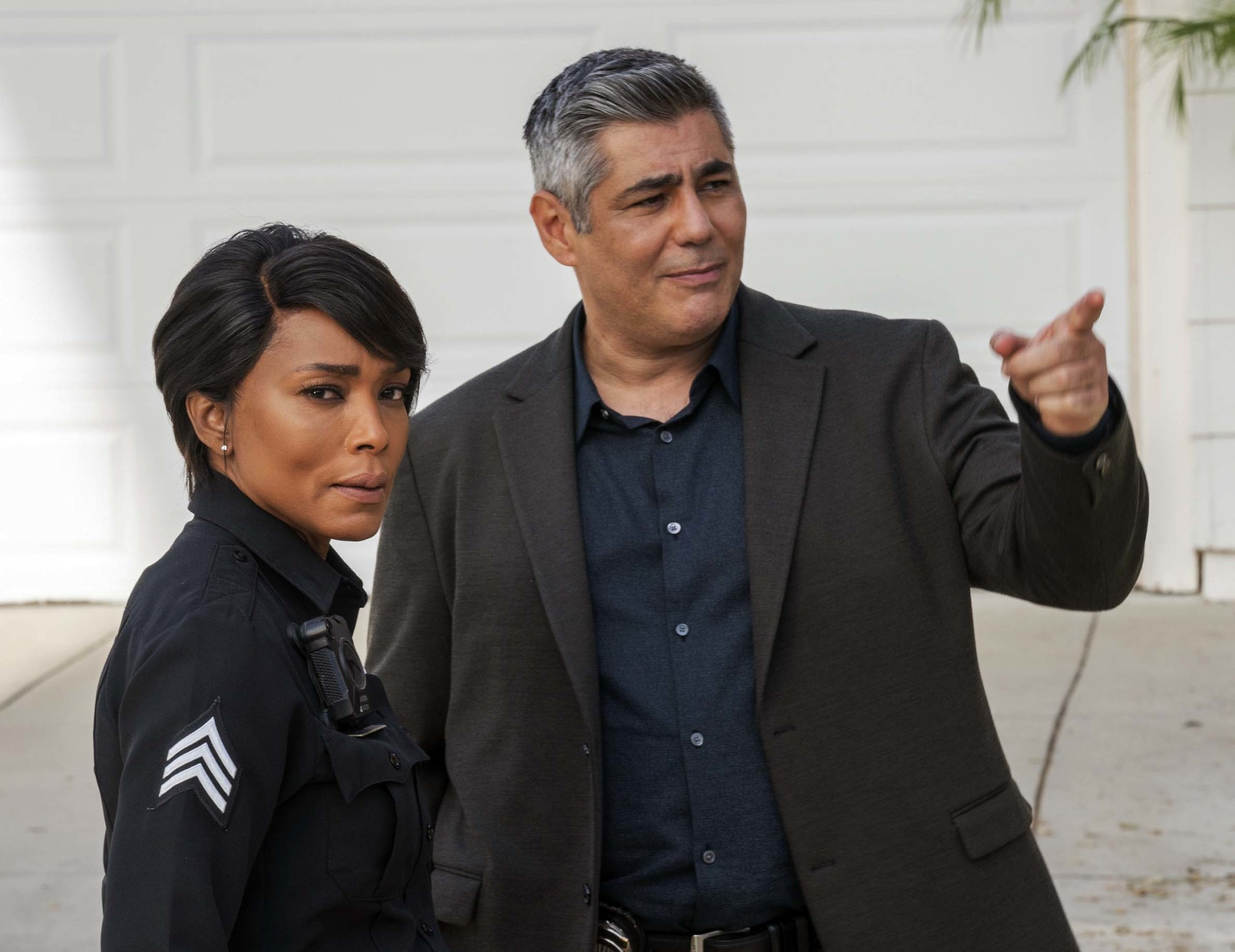 """9-1-1: L-R: Angela Bassett and guest star Danny Nucci in the """"9-1-1, What's Your Grievance"""" episode of 9-1-1 airing Monday, Feb. 8 (8:00-9:00 PM ET/PT) on FOX. CR: Jack Zeman / FOX. © 2021 FOX Media LLC."""