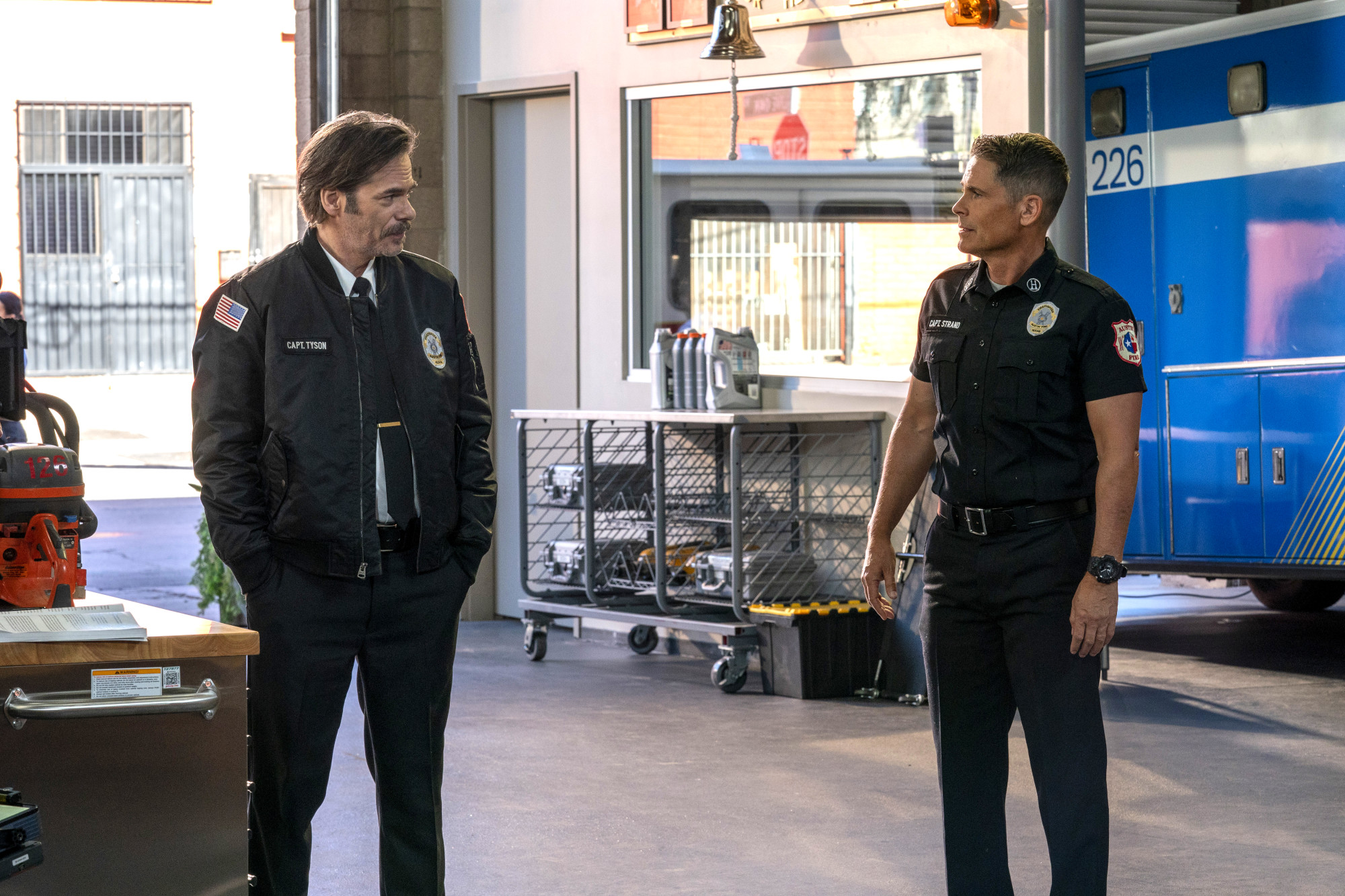 """9-1-1: LONE STAR: L-R: Guest star Billy Burke and Rob Lowe in the """"Friends Like These"""" episode of 9-1-1: LONE STAR airing Monday, Feb. 17 (8:00-9:01 PM ET/PT) on FOX. ©2020 Fox Media LLC. CR: Jack Zeman/FOX."""
