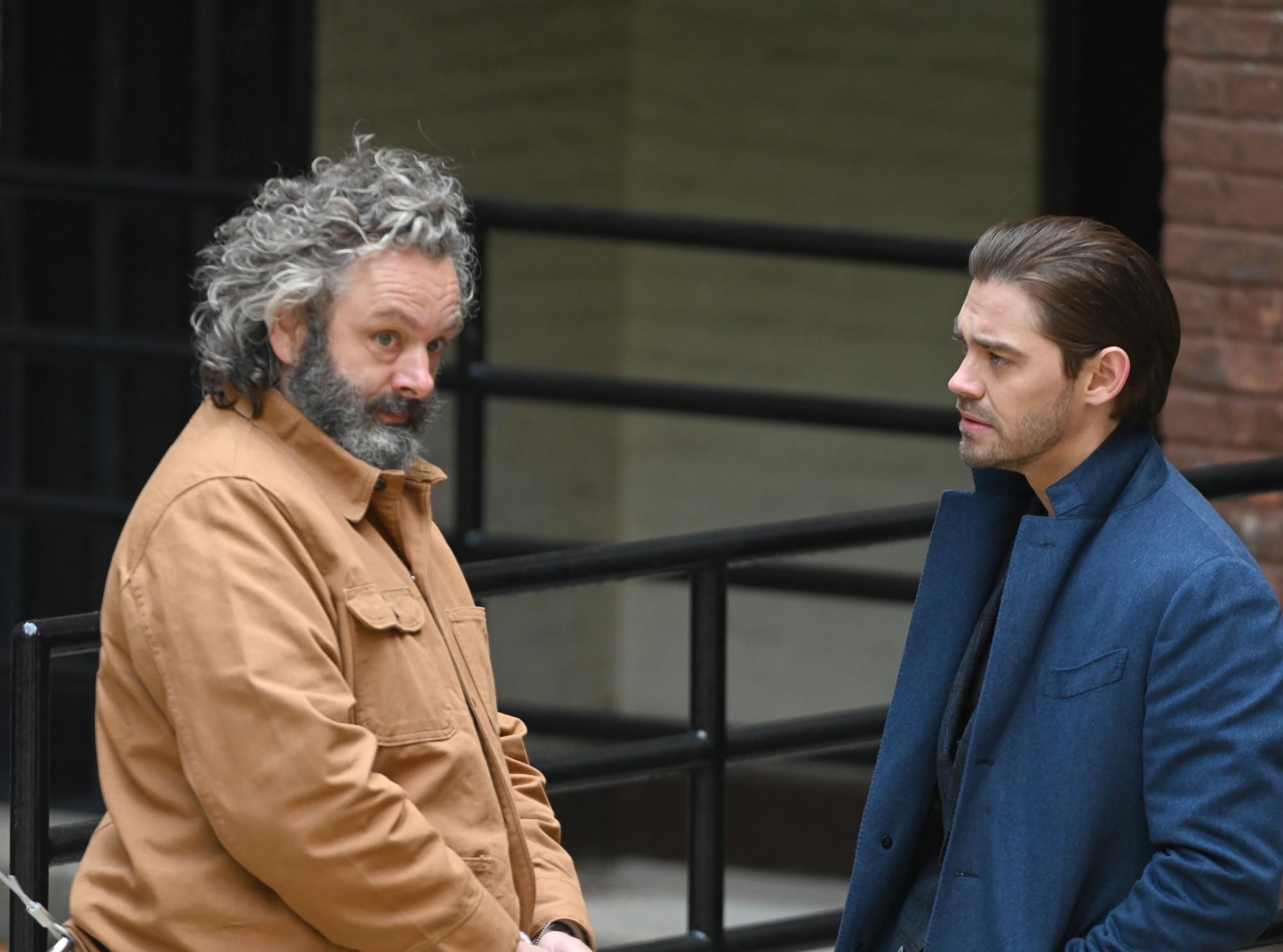 """PRODIGAL SON:  L-R: Michael Sheen and Tom Payne in the """"Speak of The Devil""""  episode of PRODIGAL SON airing Tuesday, Jan.19 (9:01-10:00 PM ET/PT) on FOX. ©2021 Fox Media LLC Cr: Phil Caruso/FOX"""