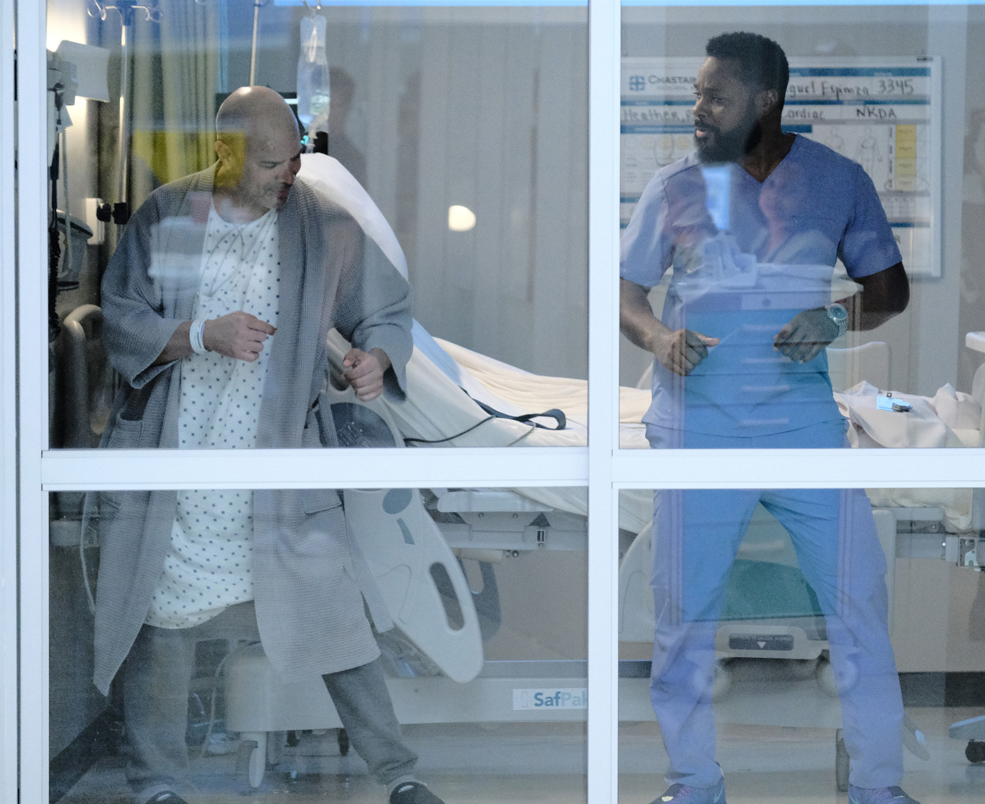 """THE RESIDENT:  L-R:  Guest star Phillip Anthony-Rodriguez and Malcolm-Jamal Warner in the """"Burn it All Down"""" season finale episode of THE RESIDENT airing Tuesday, April 7 (8:00-9:00 PM ET/PT) on FOX. ©2020 Fox Media LLC Cr: Guy D'Alema/FOX"""