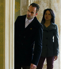 Jonny Lee Miller and Lucy Liu in Elementary. Image © CBS